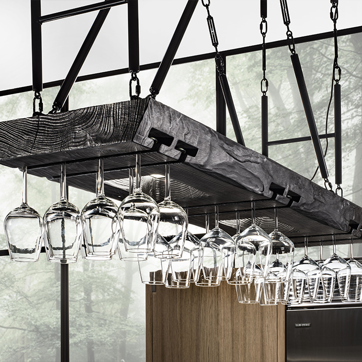 Wine glasses hanging from a rack in the kitchen