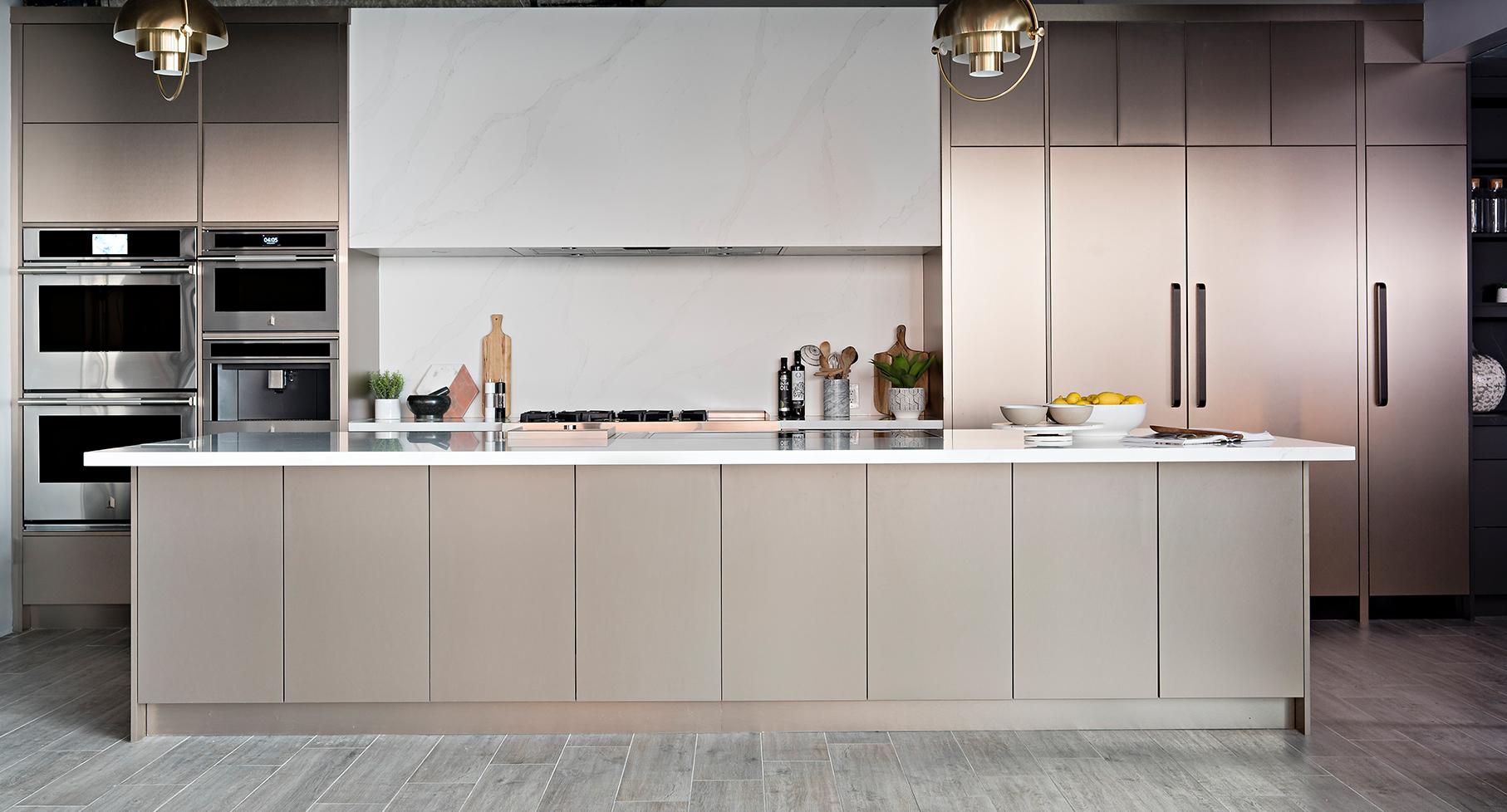 full jenn-air kitchen image of integrated fridge, wall ovens, coffee machine and range